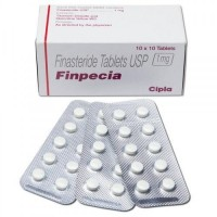 A box and three blisters of generic Finasteride 1mg tablets